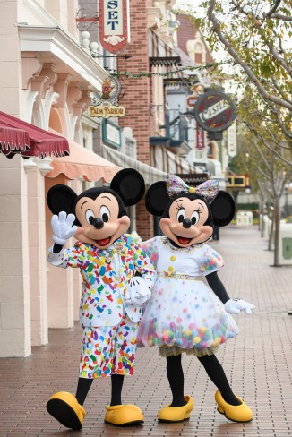 Mickey Mouse and Minnie Mouse don new outfits bursting with color to commemorate 90 years of magic in celebrations across Disney Parks. Beginning in January 2019 at the Disneyland Resort in Anaheim, Calif., guests are invited to Get Your Ears On - A Mickey and Minnie Celebration. The special party will feature new entertainment and decor at Disneyland park, plus limited-time food and beverage offerings and festive merchandise available throughout the resort. (Richard Harbaugh/Disneyland Resort)